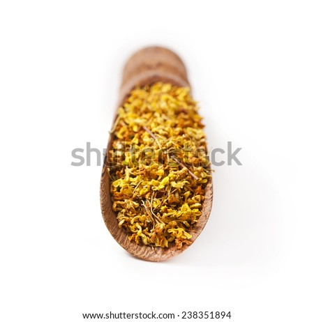 """Osmanthus """"Fragrant Flower"""" Tea in the wooden scoop isolated on white background  - stock photo"""