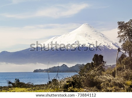 Osorno volcano behind Llanquihue lake, in the south of Chile - stock photo