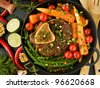 Osso buco (braised veal shank) and stir-fry veggies. Viewed from above. - stock photo