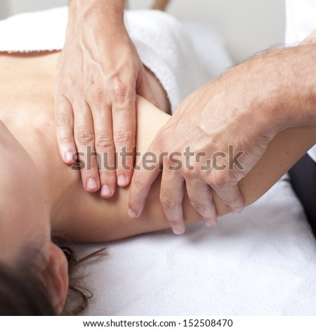 Osteopathy shoulder manipulation - stock photo