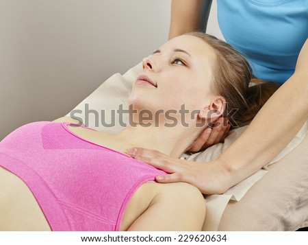 Osteopathy treatment the professional masseuse and her patient