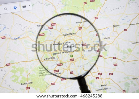 Ostersund, Sweden - Aug 14, 2016: Paris on Google Maps under a magnifying glass. Paris is the capital city of France