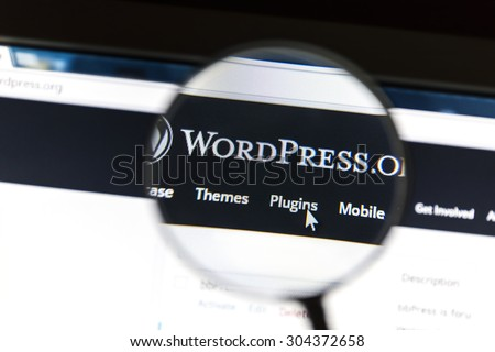 Ostersund, Sweden - August 9, 2015: Close up of Wordpress website under a magnifying glass. WordPress is a free and open source blogging tool. - stock photo