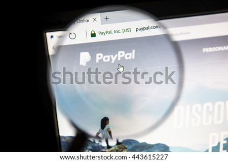 Ostersund, Sweden - June 27, 2016: Paypal  website on under a magnifying glass. PayPal is an international e-commerce business allowing payments and money transfers.