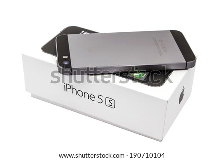 Ostersund, Sweden - May 2, 2014 : iPhone 5s and the box isolated on white background. Apple IPhone is one of the most popular smart phones in the world.  - stock photo
