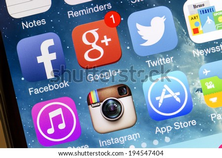 OSTERSUND, SWEDEN - MAY 14, 2014: Social media icons on Iphone 5s. Social media is the interaction among people in which they create, share or exchange information and ideas. - stock photo