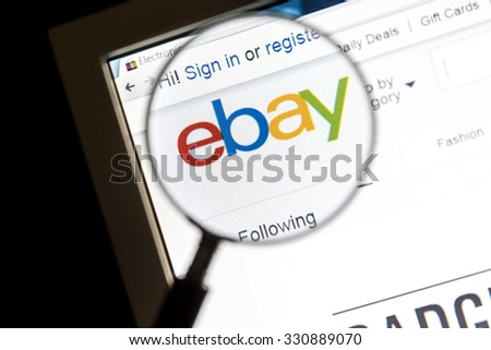 Ostersund, Sweden - October 24, 2015: Closeup of ebay website under a magnifying glass. eBay is an american multinational corporation and e-commerce company