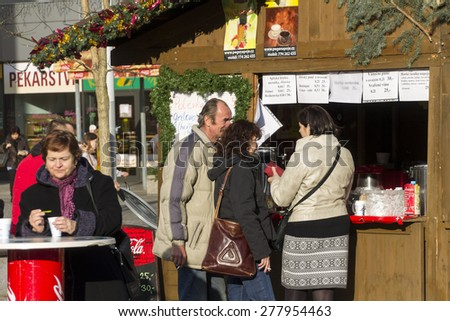 OSTRAVA, CZ - DECEMBER 17: People shopping at the raditional Christmas markets at Masaryk square, Ostrava. They open in December and sell Christmas gifts,meals and decorations