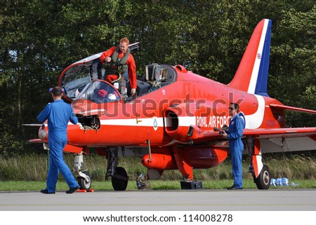 OSTRAVA, CZECH REPUBLIC-SEPTEMBER 22: Pilot of the RAF aerobatic team Red Arrows during airshow session NATO Days on September 22, 2012 in Ostrava, Czech republic. 208 000 people visited NATO Days. - stock photo