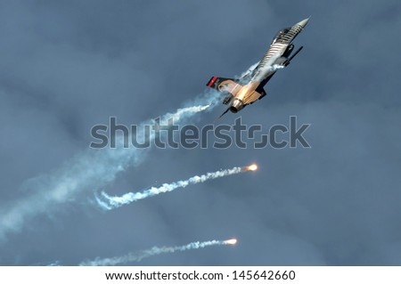 OSTRAVA, CZECH REPUBLIC-SEPTEMBER 23: Turkish F-16 Falcon - Display Team Solo Turk performs during airshow session NATO Days on September 23, 2012 in Ostrava, Czech republic - stock photo