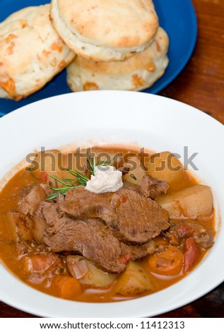 Buttered biscuits and gravy Stock Photos, Illustrations, and Vector ...