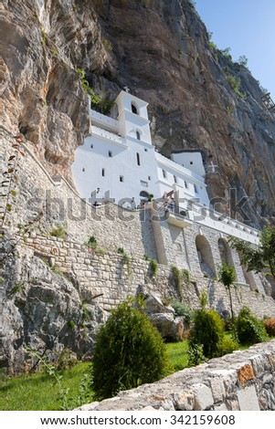 OSTROG, MONTENEGRO - SEPTEMBER 22, 2015 : Pilgrims and other visitors in the Ostrog Monastery, a Serbian Orthodox Monastery in Ostrog, Montenegro - stock photo