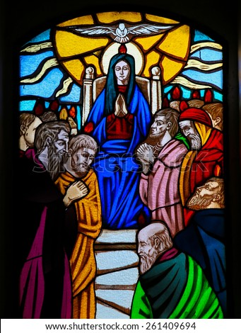 OSTUNI, ITALY - MARCH 14, 2015: Stained glass window depicting the Descent of the Holy Spirit at Pentecost  in the Church of Ostuni, Apulia, Italy. - stock photo