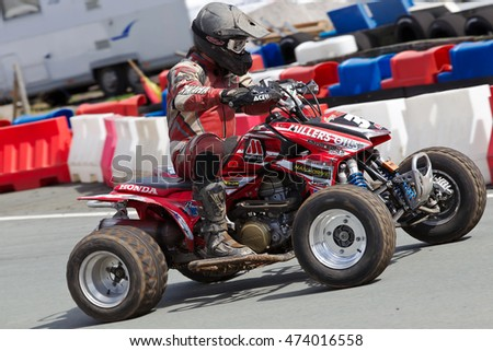 OSWESTRY, UK - APRIL 27: An unnamed rider competing in the NoraSport UK quad bike championship negotiates a series of tight corners at the Rednal race circuit on April 27, 2013 in Oswestry