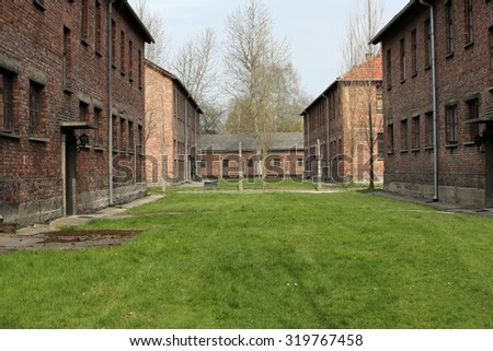 OSWIECIM, POLAND - APRIL 16, 2015: Buildings in the former German concentration camp in Oswiecim, Poland Oswiecim was the largest German concentration camp in Poland during World War II. - stock photo