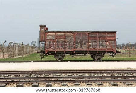 OSWIECIM, POLAND - APRIL 16, 2015: Deportation wagon at Auschwitz Birkenau at Auschwitz Birkenau concentration camp, Poland - stock photo