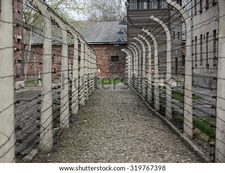 OSWIECIM, POLAND - APRIL 16, 2015: Electric fence in former Nazi concentration camp Auschwitz I, Poland