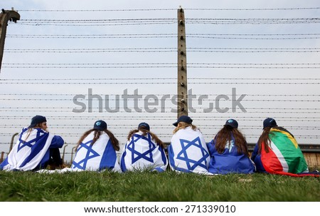 OSWIECIM, POLAND - APRIL 16, 2015: Holocaust Remembrance Day next generation of people from the all the world meets on the March of the Living in   German death camp in Auschwitz Birkenau, in Poland - stock photo