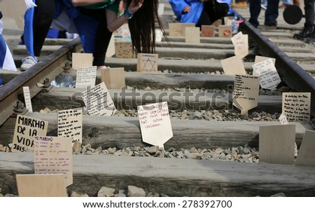 OSWIECIM, POLAND - APRIL 16, 2015: International Holocaust Remembrance Day . Annually people from the all the world meets on the March of the Living in german Concentration Camp in Auschwitz Birkenau - stock photo