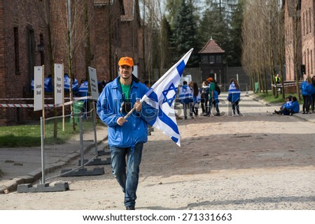 OSWIECIM, POLAND - APRIL 16, 2015: International Holocaust Remembrance Day.  People from the all the world meets on the March of the Living in german Concentration Camp in Auschwitz Birkenau.Poland