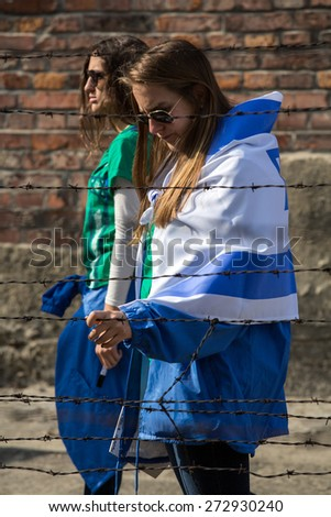 OSWIECIM, POLAND - APRIL 16, 2015:the next generation of people from the all the world meet on the March of the Living in german Concentration Camp in Auschwitz Birkenau.Poland - stock photo