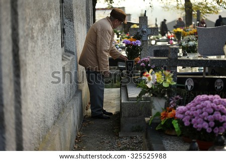 OSWIECIM, POLAND - NOVEMBER 1, 2013: Graves in autumn. Municipal Cemetery in Oswiecim, Poland