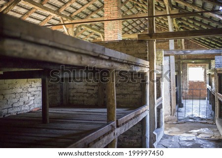 OSWIECIM, POLAND - OCT 29: A row of bunk beds at a concentration camp memorial site on October 29, 2013 in Oswiecim, Poland