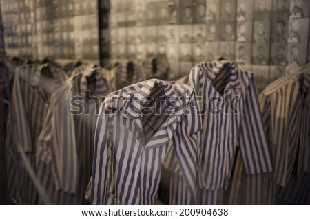 OSWIECIM, POLAND - OCT 29: The scary exhibition with prisoners' clothes shown in the concentration camp of Auschwitz on October 29 2013 in Oswiecim, Poland. - stock photo