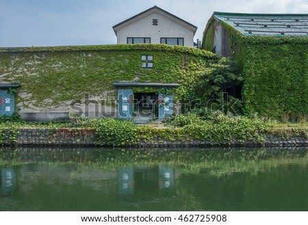 OTARU CITY, JAPAN - AUGUST 1ST, 2016. Old stone warehouses lining up Otaru Canal in Otaru City, Japan. Otaru is popular tourist destination and a port city in the island of Hokkaido, Japan.