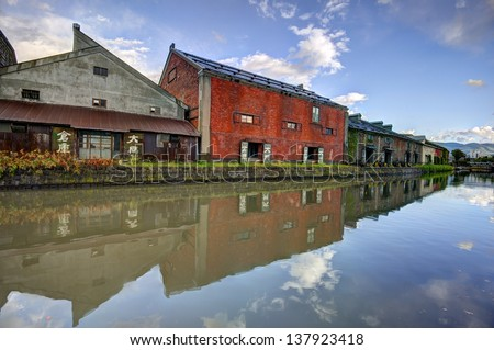 OTARU, JAPAN - OCTOBER 20: Warehouses along the famed canal October 20, 2012 in Otaru, JP. The historic structures date from early colonialization of Hokkaido in the early 1800's.