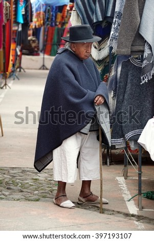 OTAVALO, ECUADOR - FEBRUARY 13, 2016: Old man in traditional dress in the Otavalo Market