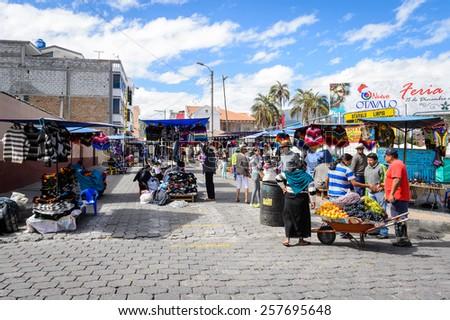 OTAVALO, ECUADOR - JAN 3, 2015: Unidentified Ecuadorian people at the Otavalo Market. 71,9% of Ecuadorian people belong to the Mestizo ethnic group - stock photo
