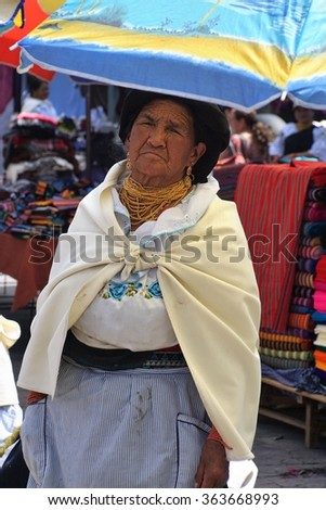 OTAVALO, ECUADOR - JANUARY 9, 2016: Quechua woman in traditional dress in the Otavalo Market