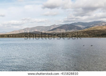 Otay Lakes County Park with mountains and cloudy sky in the background in Chula Vista, California.