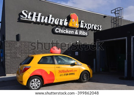 OTTAWA, CANADA - APR 2, 2016:  Delivery parked at St. Hubert, the Quebec based casual dining restaurant that was purchased by Cara Operations which also owns the Canadian rival Swiss Chalet chain. - stock photo