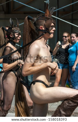 OTTAWA, CANADA - AUGUST 26: A man and woman being submissive in the Capital Pride Parade on August 26, 2012 in Ottawa, Ontario.