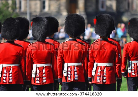 OTTAWA, CANADA - AUGUST 23: The Changing Guard Ceremony takes place at Parliament Hill on August 23, 2011 in Ottawa, Canada. The ceremony is performed in every day in the summer months. - stock photo