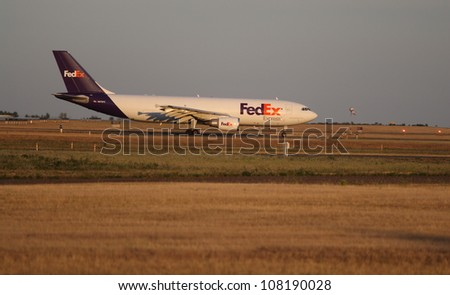 OTTAWA, CANADA - JULY 20: A FedEx Express cargo jet waiting to takeoff on July 20, 2012 in Ottawa, Ontario. FedEx Express delivers more than 3 million packages daily throughout the world. - stock photo