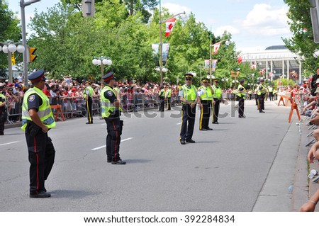 OTTAWA, CANADA - JULY 1: RCMP police on guard on Canada Day on July 1, 2011 in Ottawa, Ontario, Canada. - stock photo