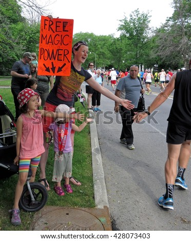 "OTTAWA, CANADA - MAY 29, 2016: An Ottawa family offers ""Free Magic Power"" to runners in the Scotiabank Ottawa Half-Marathon."