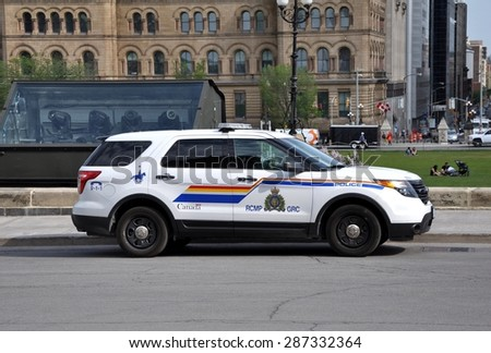 Ottawa, Canada - May 24, 2015: RCMP police is seen patrolling the Parliament Hills ground. - stock photo