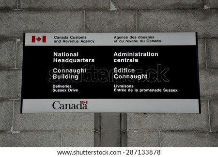 Ottawa, Canada - May 24, 2015: Sign of National Headquarters of Canada Customs and Revenue Agency. - stock photo