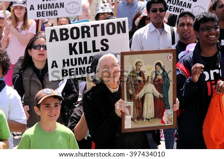 OTTAWA, CANADA - MAY 12, 2011: Thousands of people opposed to abortion take part in the annual March for Life from Parliament Hill.
