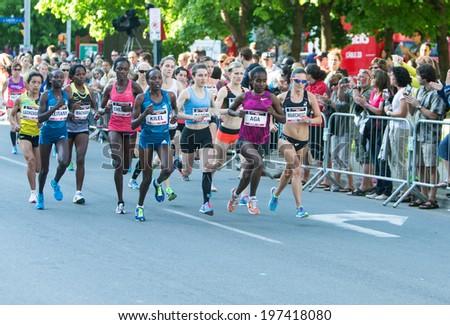 OTTAWA, CANADA � MAY 24, 2014: Unidentified elite female athletes running the 10K race in the Tamarack Ottawa Race Weekend race. - stock photo