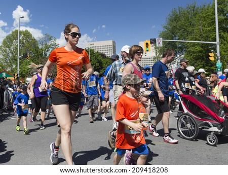 OTTAWA, CANADA � MAY 24, 2014: Unidentified participants in the 2K family race as part of the Tamarack Ottawa Race weekend. - stock photo