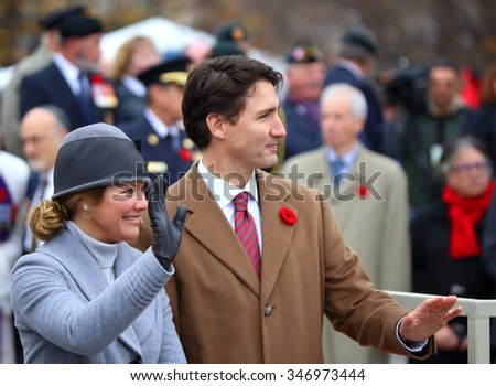 OTTAWA, CANADA  NOVEMBER 11, 2015: Newly elected Canadian Prime Minister Justin Trudeau and his wife Sophie Gregoire-Trudeau wave to war veterans at the National War Memorial.