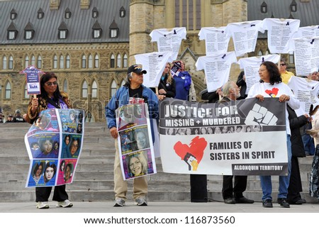 OTTAWA, CANADA  OCT 25:  Unidentified people gather hold a demonstration to demand a national plan to end violence against women on Parliament Hill Oct 25, 2012 in Ottawa, Ontario. - stock photo