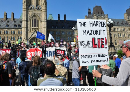 OTTAWA, CANADA - SEP 17:  Sid Ryan of the Ontario Federation of Labor speaks at a protest to mark the anniversary of the Occupy Wall Street movement on Parliament Hill Sep 17, 2012 in Ottawa, Ontario. - stock photo