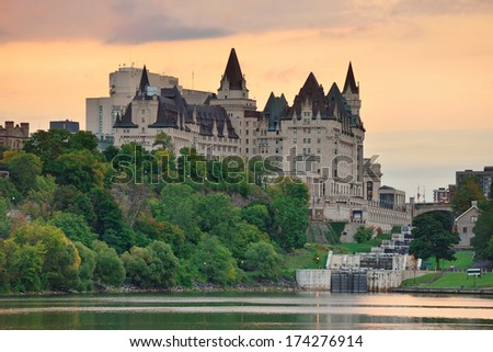 Ottawa city skyline at sunrise in the morning over river with urban historical buildings and colorful cloud - stock photo
