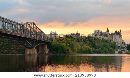 Ottawa city skyline panorama at sunrise in the morning over river with urban historical buildings and colorful cloud - stock photo